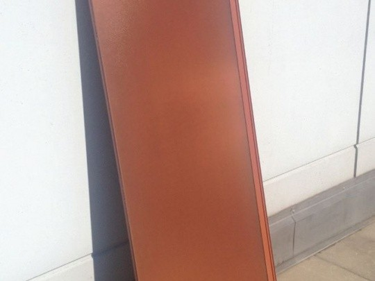 A solar module with a terracotta look.